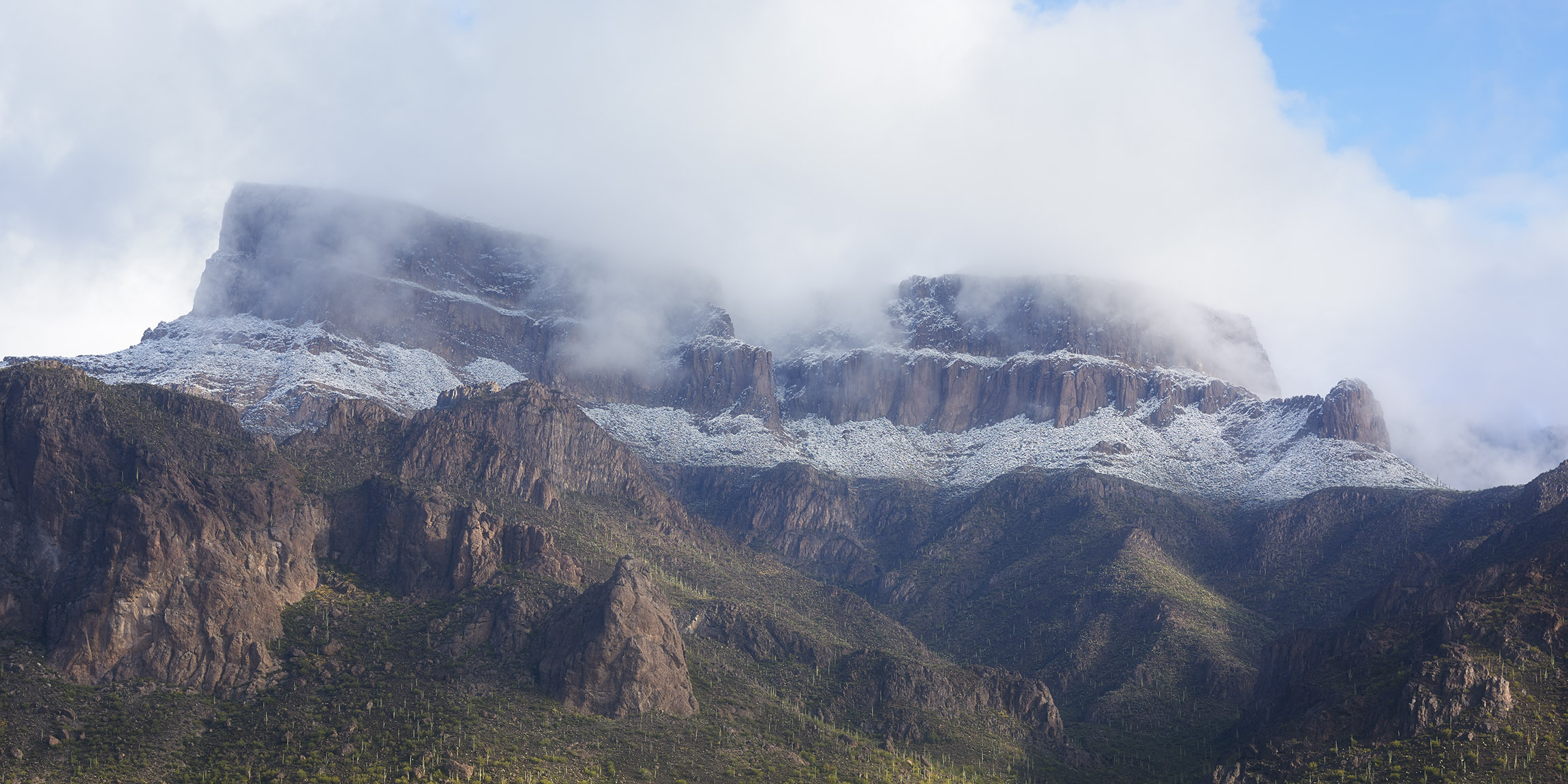 Landscape photo of Superstition Mountain in Arizona covered in snow, arizona landscape photography