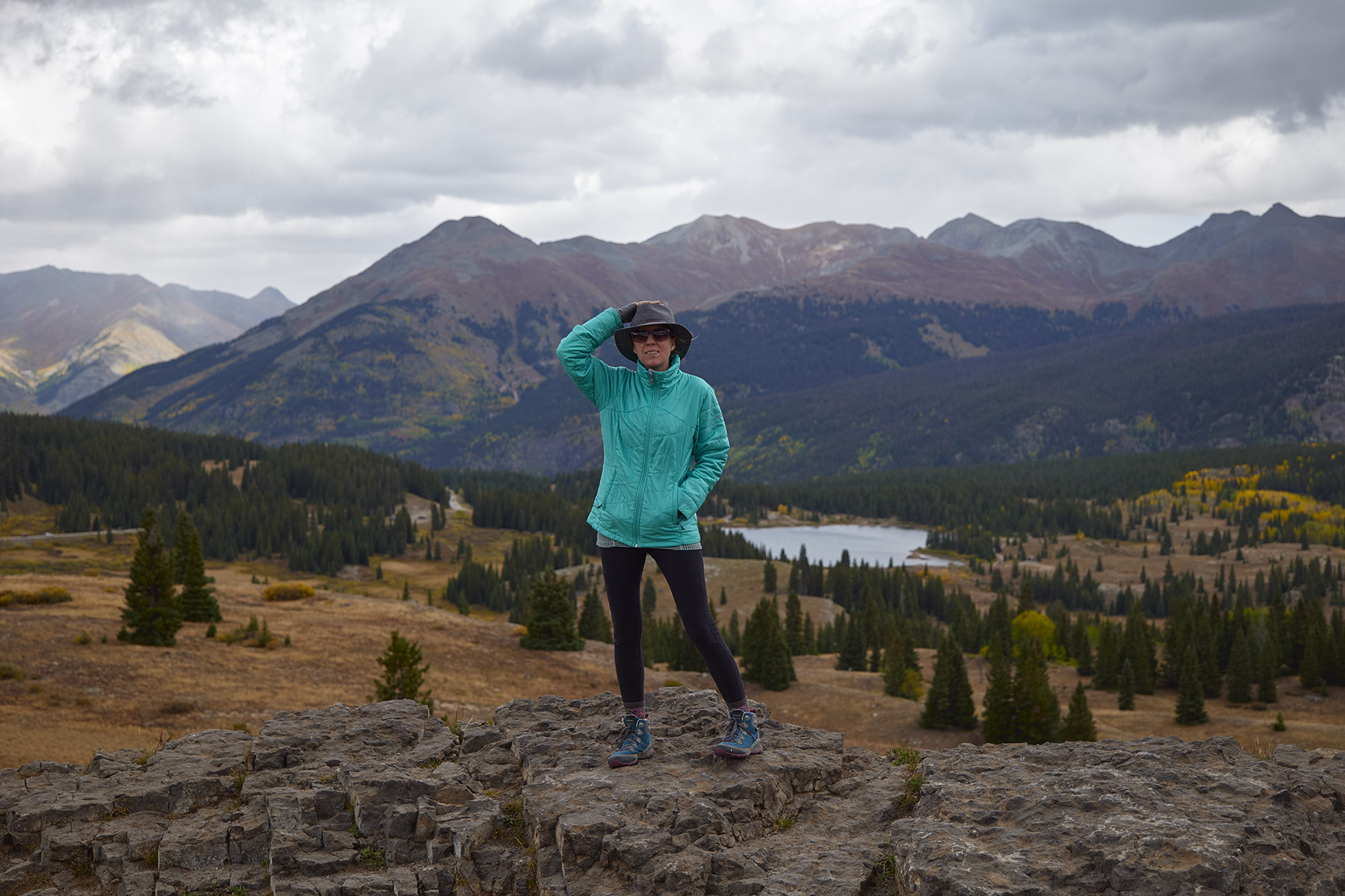 Female hiker standing on a rock in the mountains, Colorado Landscape Photography